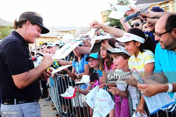 Phil Mickelson signs autographs for fans after finishing his round during Round Two of the Valero Texas Open at TPC San Antonio ATT Oaks Courseon...
