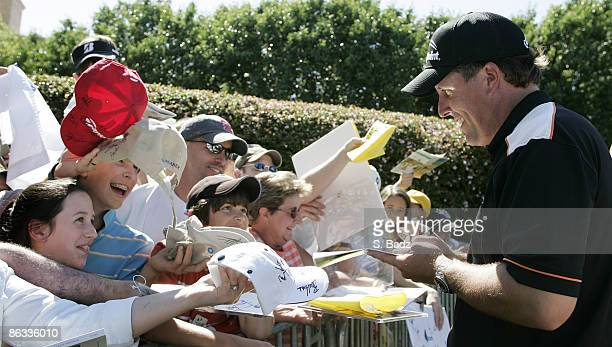 Phil Mickelson signs autographs for fans after the first round of the EDS Byron Nelson Championship on the Tournament Players Course and Cottonwood...
