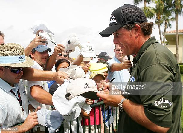 Phil Mickelson signs autographs for fans after the second round of the Ford Championship at the Doral Golf Resort and Spa on March 3, 2006 in Doral,...