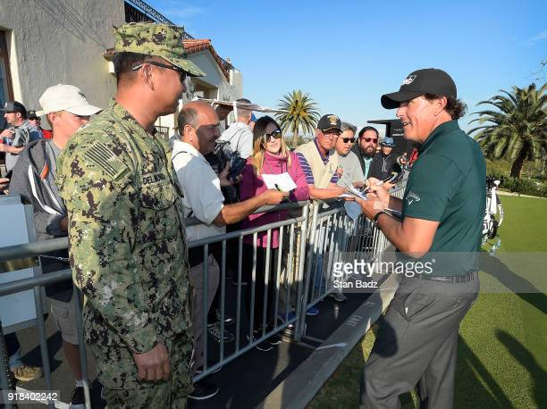 Phil Mickelson signs autographs for fans during the ProAm round for the Genesis Open at Riviera Country Club on February 14 2018 in Pacific Palisades...