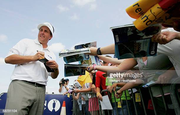 Phil Mickelson signs autographs for fans on the practice ground during the final practice round for the 134th Open Championship at Old Course St...