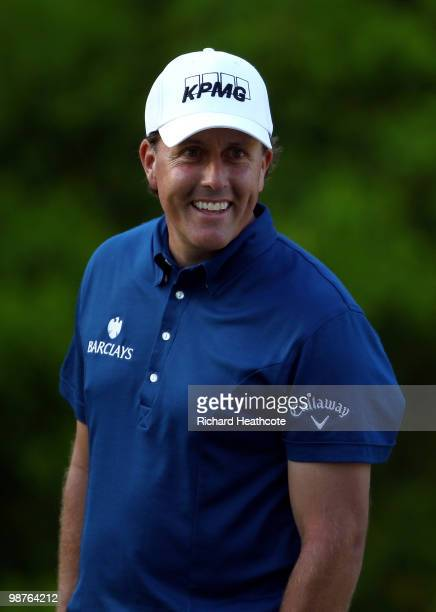Phil Mickelson smiles as he waits to putt on the 12th green during the second round of the Quail Hollow Championship at Quail Hollow Country Club on...