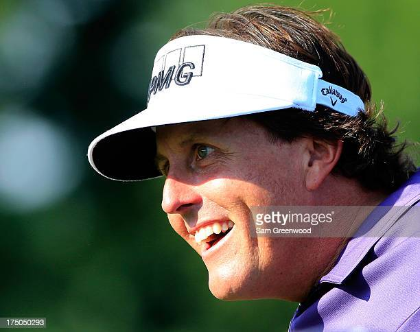 Phil Mickelson smiles during a practice round prior to the World Golf ChampionshipsBridgestone Invitational at Firestone Country Club South Course on...