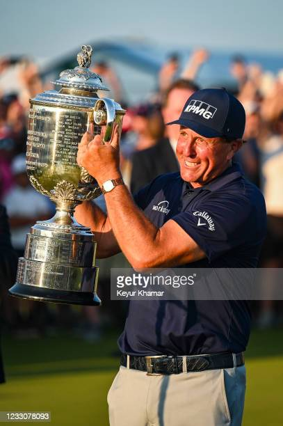 Phil Mickelson smiles with the Wanamaker Trophy after his two stroke victory in the final round of the PGA Championship on The Ocean Course at Kiawah...