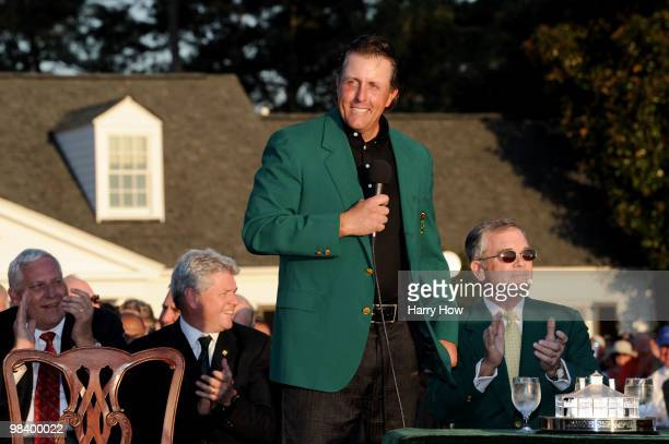 Phil Mickelson speaks to the gallery as Augusta National Chairman William Porter 'Billy' Payne looks on during the green jacket presentation after...
