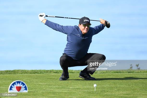 Phil Mickelson stretches on the 11th hole on the North Course during the first round of the Farmers Insurance Open golf tournament at Torrey Pines...