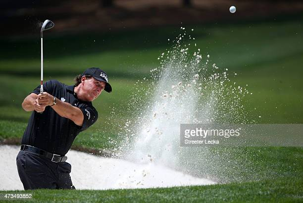 Phil Mickelson takes his shot out of the bunker on the fifth hole during round two at the Wells Fargo Championship at Quail Hollow Club on May 15,...