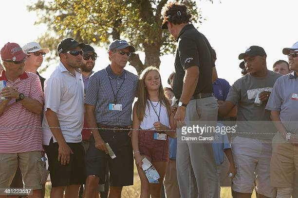 Phil Mickelson talks with a young fan on the15th during Round Two of the Valero Texas Open at TPC San Antonio ATT Oak Course on March 28 2014 in San...