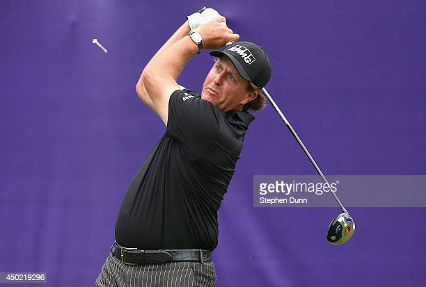 Phil Mickelson tees off on the first hole to start his round during the continuation of the second round of the FedEx St Jude Classic at the TPC...