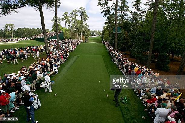 Phil Mickelson tees off the 18th hole during the continuation of the rain delayed third round of The Masters at the Augusta National Golf Club on...
