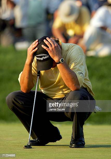 Phil Mickelson waits on the 18th green during the final round of the 2006 US Open Championship at Winged Foot Golf Club on June 18 2006 in Mamaroneck...