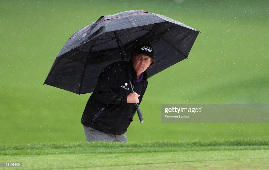 Phil Mickelson waits to hit a shot on the 15th hole during the final round of the Wells Fargo Championship at Quail Hollow Club on May 5, 2013 in Charlotte, North Carolina.