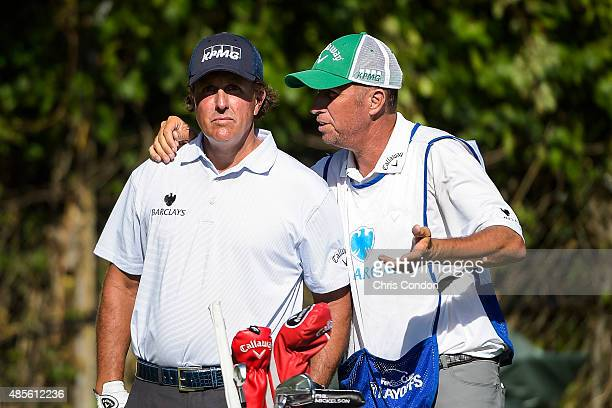 Phil Mickelson waits to tee off on the 18th hole with his caddie Jim 'Bones' Mackay during the second round of The Barclays at Plainfield Country...