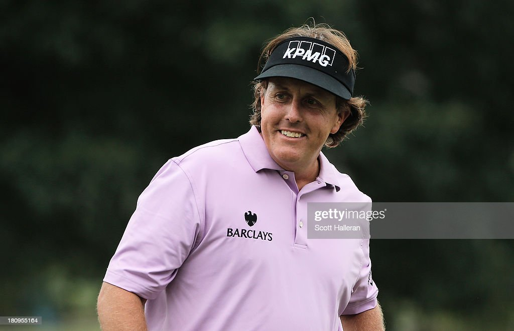 Phil Mickelson walks across a green during a practice round prior to the start of the TOUR Championship by Coca-Cola at East Lake Golf Club on September 18, 2013 in Atlanta, Georgia.
