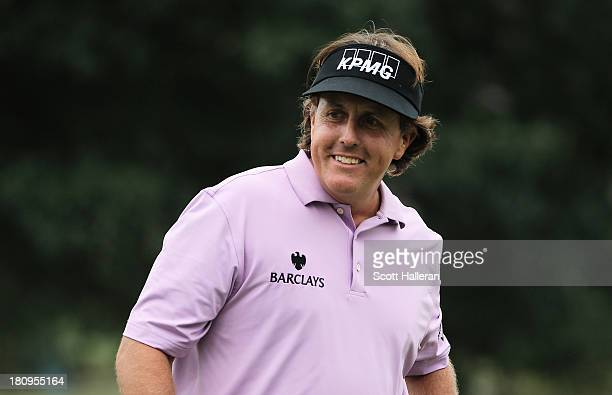 Phil Mickelson walks across a green during a practice round prior to the start of the TOUR Championship by CocaCola at East Lake Golf Club on...