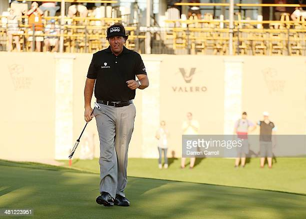 Phil Mickelson walks off the 18th green during Round Two of the Valero Texas Open at TPC San Antonio ATT Oaks Courseon March 28 2014 in San Antonio...