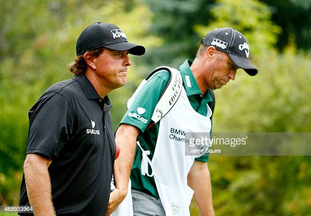 Phil Mickelson walks with his caddie Jim 'Bones' Mackay during the Second Round of the BMW Championship at Conway Farms Golf Club on September 18...