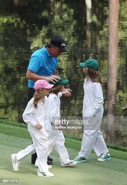 Phil Mickelson walks with his caddies/children Sophi Evan and Amanda during the Par 3 Contest prior to the 2010 Masters Tournament at Augusta...