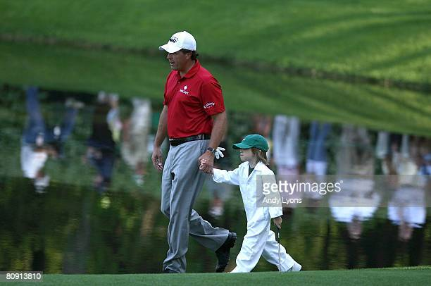 Phil Mickelson walks with his son Evan Mickelson during the Par 3 Contest at the 2008 Masters Tournament at Augusta National Golf Club on April 9...