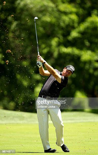 Phil Mickelson watches a shot on the 9th hole during the first round of the Quail Hollow Championship at Quail Hollow Country Club on April 29 2010...