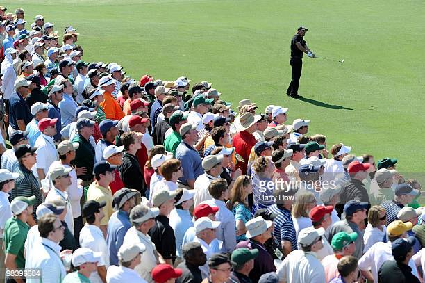 Phil Mickelson watches a shot on the ninth hole during the final round of the 2010 Masters Tournament at Augusta National Golf Club on April 11, 2010...
