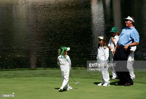 Phil Mickelson watches his daughter Amanda miss a putt on ninth green alongside his other Sophia during the Par3 contest prior to the start of The...