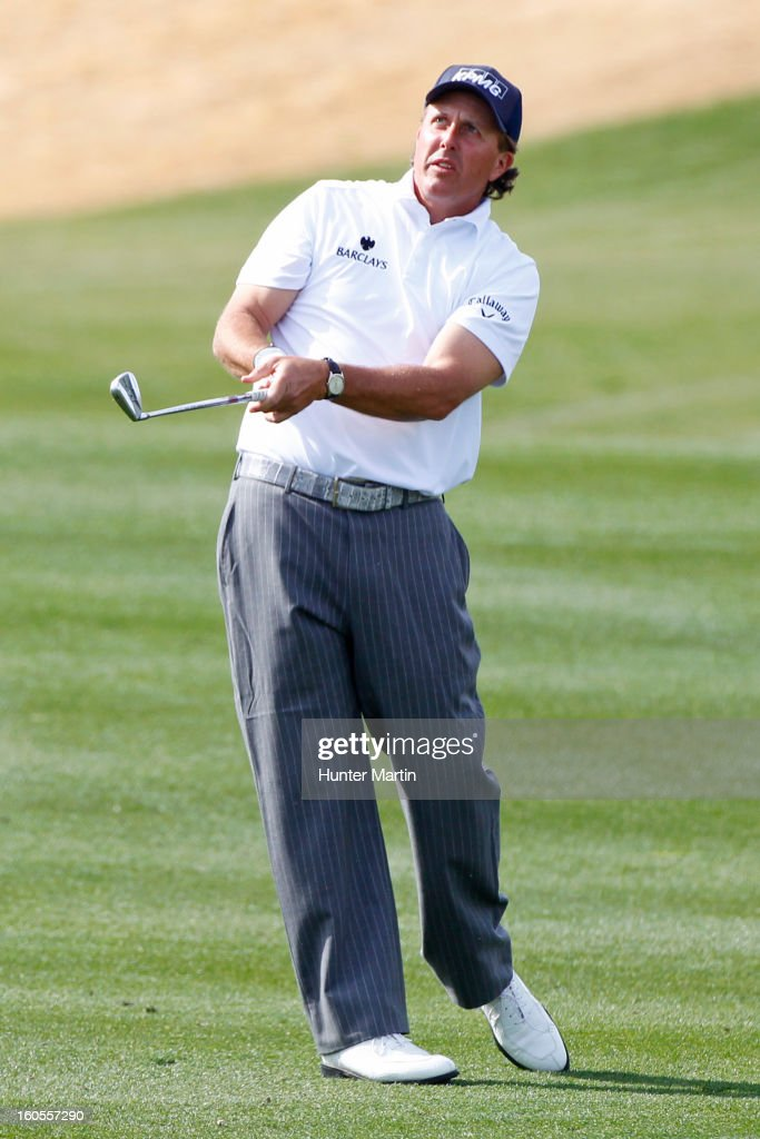 Phil Mickelson watches his second shot on the ninth hole during the third round of the Waste Management Phoenix Open at TPC Scottsdale on February 2, 2013 in Scottsdale, Arizona.