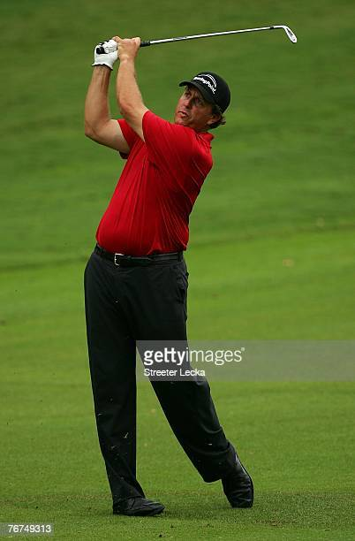 Phil Mickelson watches his shot from the fairway on the first hole during the second round of the TOUR Championship the final event of the new PGA...