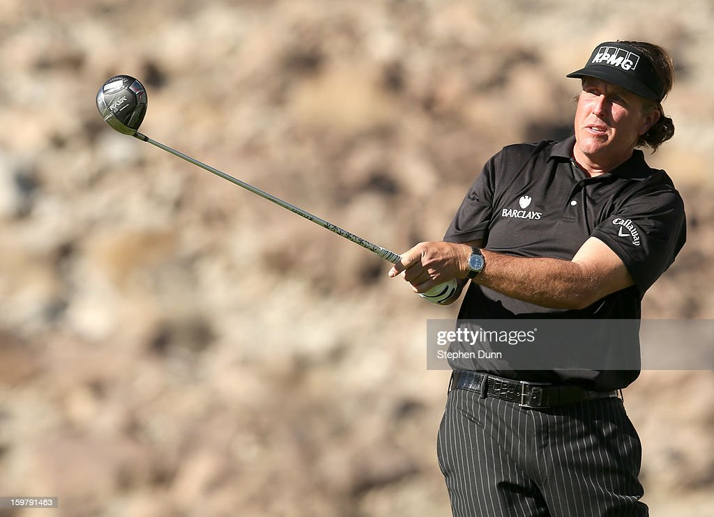 Phil Mickelson watches his tee shot on the 14th hole during the final round of the Humana Challenge In Partnership With The Clinton Foundation on the Palmer Private Course at PGA West on January 20, 2013 in La Quinta, California.