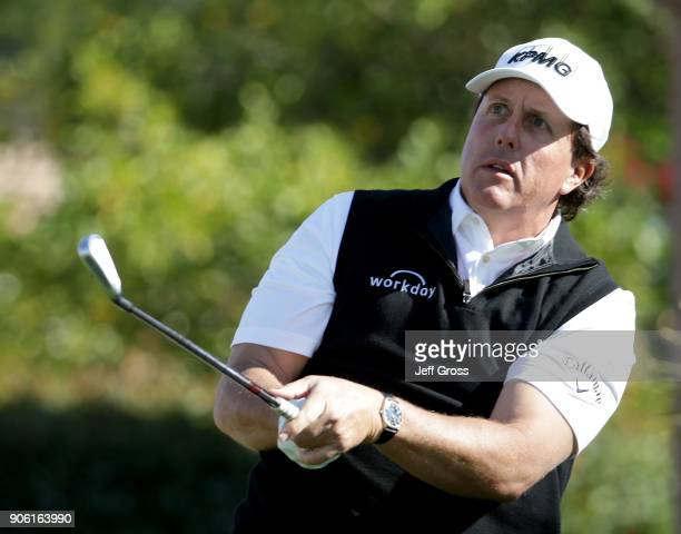 Phil Mickelson watches his tee shot on the 17th hole during practice for the CareerBuilder Challenge at the Jack Nicklaus Tournament Course at PGA...