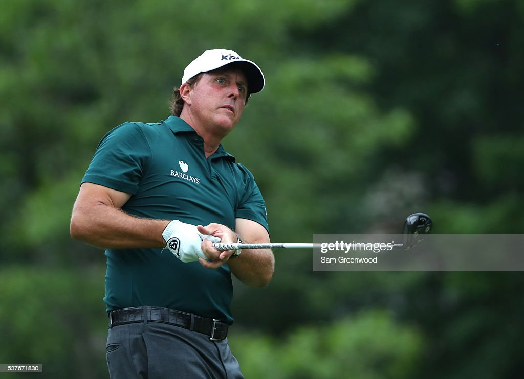 Phil Mickelson watches his tee shot on the 18th hole during the first round of The Memorial Tournament at Muirfield Village Golf Club on June 2, 2016 in Dublin, Ohio.