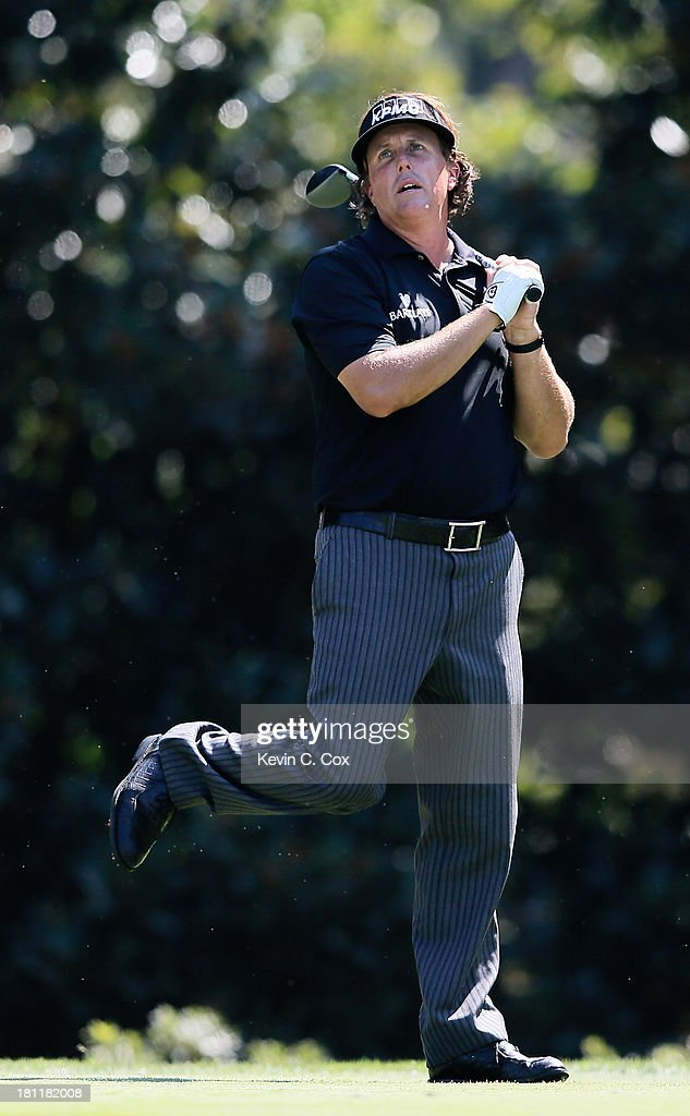 Phil Mickelson watches his tee shot on the eighth hole during the first round of the TOUR Championship by Coca-Cola at East Lake Golf Club on September 19, 2013 in Atlanta, Georgia.