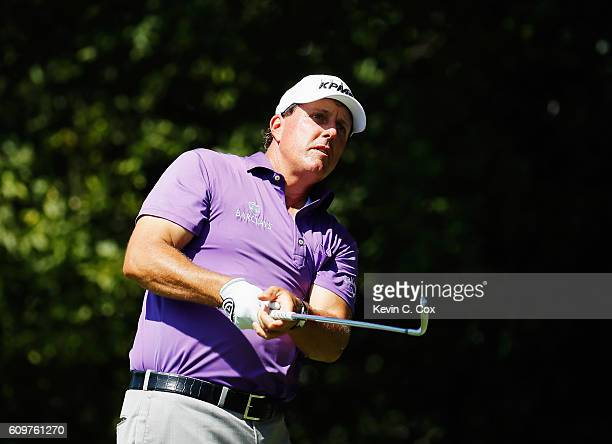 Phil Mickelson watches his tee shot on the second hole during the first round of the TOUR Championship By CocaCola at East Lake Golf Club on...