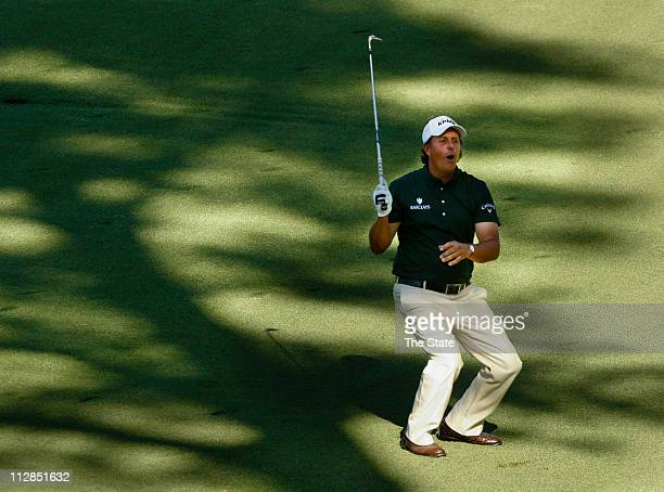 Phil Mickelson who eagled the 13th and 14th holes reacts as he narrowly misses an eagle on 15 during the third round of the the Masters at Augusta...