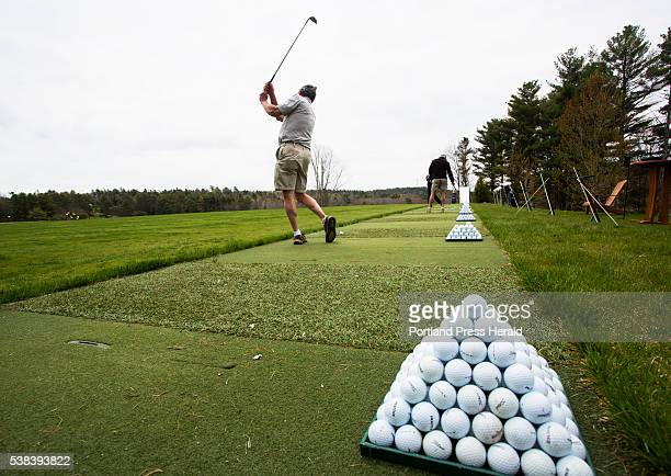 Phil Molvar of Southport swings on the driving range at Boothbay Harbor Country Club on the first day the club opened the practice facility The...