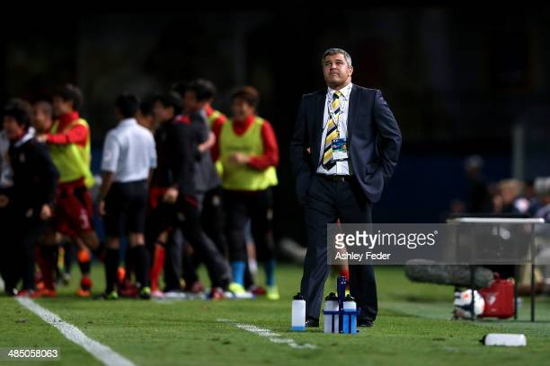 Phil Moss coach of the Mariners looks dejected after conceding a goal in extra time to lose 01 during the AFC Asian Champions League match between...