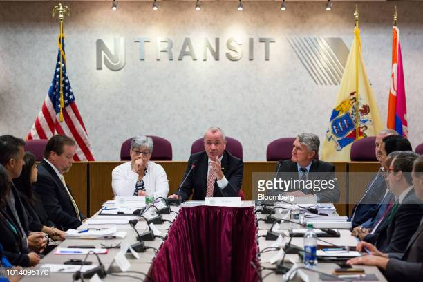 Phil Murphy governor of New Jersey center speaks during a press briefing at NJ Transit headquarters in Newark New Jersey US on Thursday Aug 9 2018...