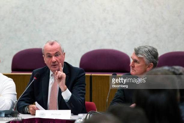 Phil Murphy governor of New Jersey left speaks during a press briefing at NJ Transit headquarters in Newark New Jersey US on Thursday Aug 9 2018...