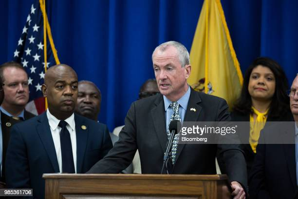 Phil Murphy governor of New Jersey speaks while Ras Baraka mayor of Newark left listens during a budget press conference in Newark New Jersey US on...