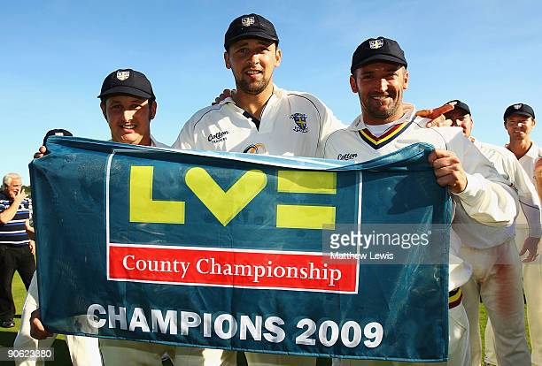 Phil Mustard Steve Harmison and Michael Di Venuto of Durham celebrate after winning the LV County Championship Division One during the final day of...