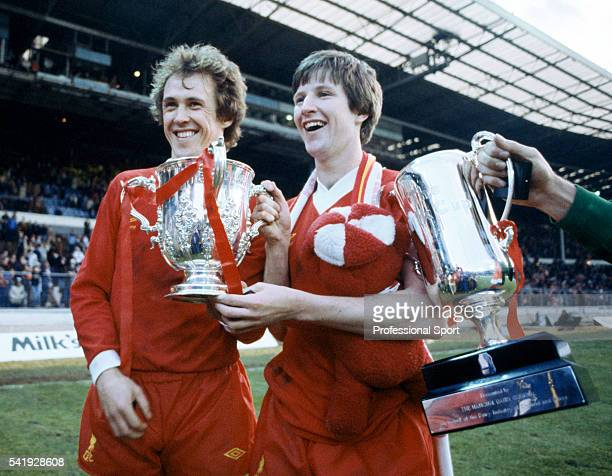 Phil Neal and Ronnie Whelan of Liverpool holding the League Cup following their victory over Tottenham Hotspur in the League Cup Final, sponsored by...