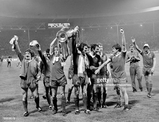 Phil Neal holds the trophy aloft with goalkeeper Ray Clemence as Liverpool celebrate after the European Cup Final between Liverpool and Club Brugge...