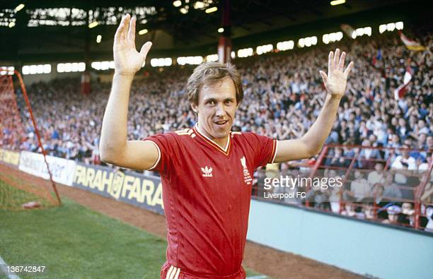 Phil Neal of Liverpool acknowledges the supporters in front of the Kop prior to the start of his testimonial match between Liverpool and Everton held...