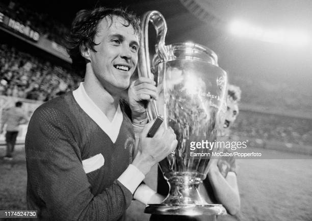 Phil Neal of Liverpool celebrates with the trophy after the 1981 European Cup Final between Liverpool and Real Madrid at the Parc des Princes on May...