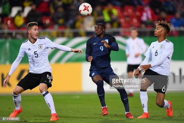 Phil Neumann and Sidney Friede of Germany and Stephy Mavididi of England vie for the ball during the Under 20 International Friendly match between...