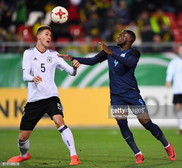 Phil Neumann of Germany and Stephy Mavididi of England vie for the ball during the Under 20 International Friendly match between U20 of Germany and...