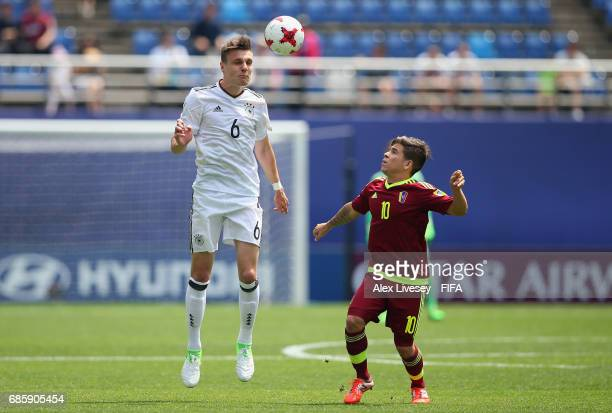 Phil Neumann of Germany wins the ball ahead of Yeferson Soteldo of Venezuela during the FIFA U20 World Cup Korea Republic 2017 group B match between...