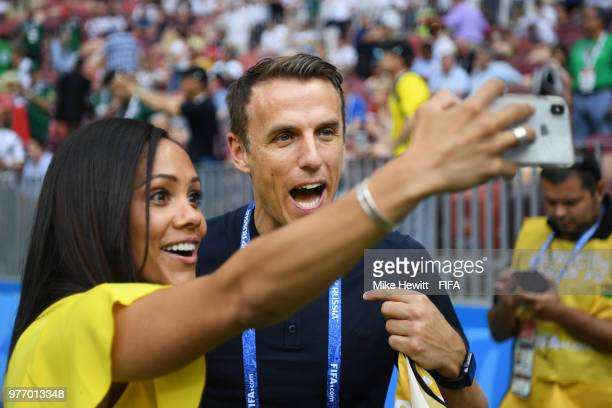 Phil Neville a Former England International now Women's national coach and TV commentator poses for a selfie with tv football commentator Alex Scott...