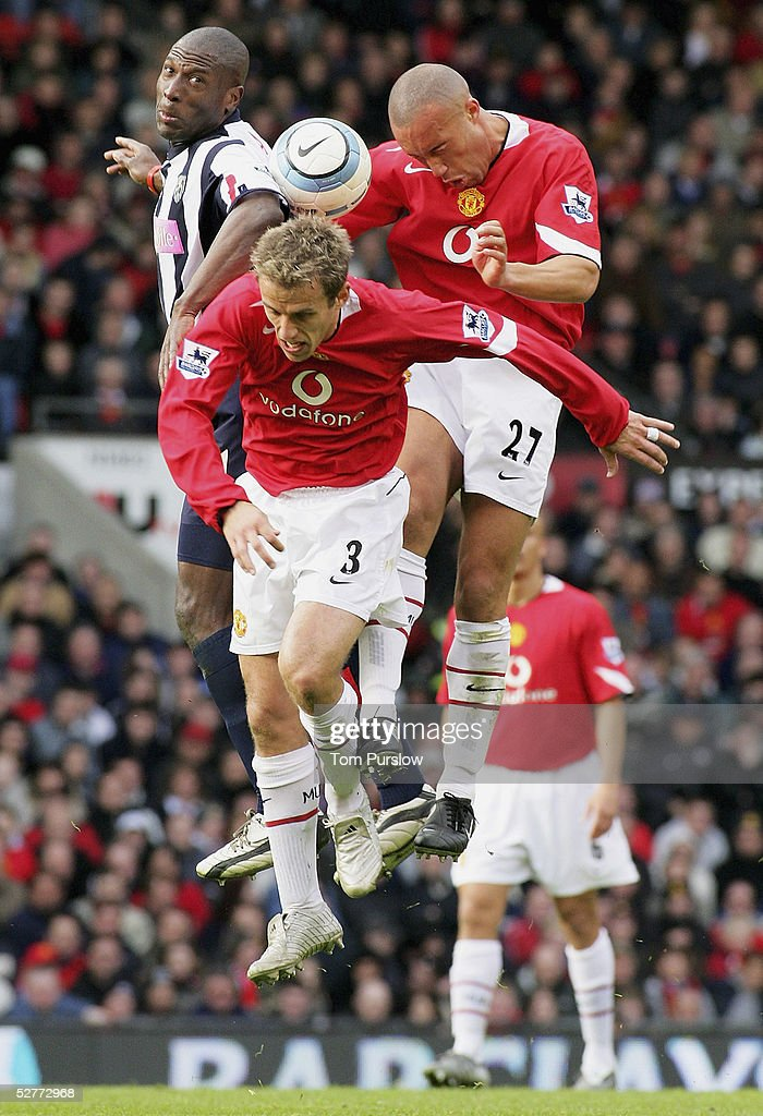 Phil Neville (C) and Mikael Silvestre of Manchester United clash with Kevin Campbell of West Bromwich Albion during the Barclays Premiership match between Manchester United and West Bromwich Albion at Old Trafford on May 7 2005 in Manchester, England.