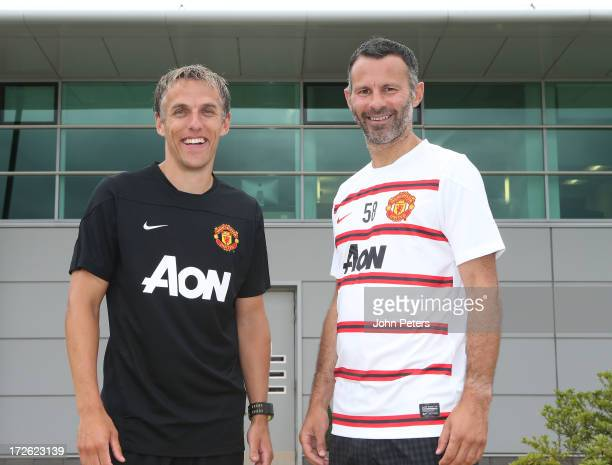 Phil Neville and Ryan Giggs of Manchester United pose after Neville was appointed first team coach and Giggs was appointed player/coach at the Aon...